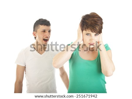 Young man shouting at young woman isolated on white background - stock photo