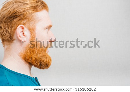 Young man shouting in profile  - stock photo