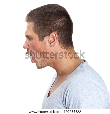 Young man shouting in profile on white isolated background