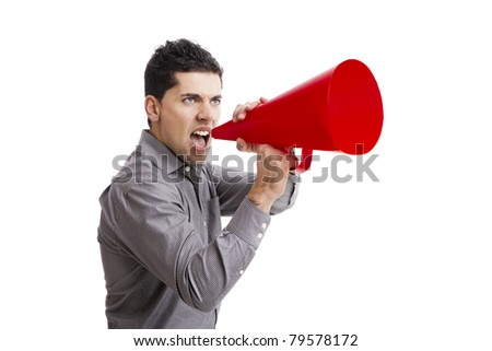 Young man shouting into a megaphone over a white background - stock photo