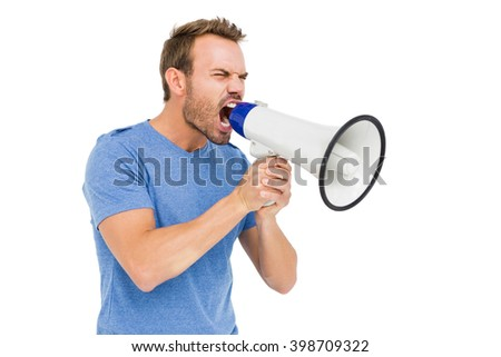 Young man shouting on horn loudspeaker on white background - stock photo
