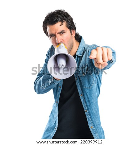Young man shouting over isolated white background - stock photo