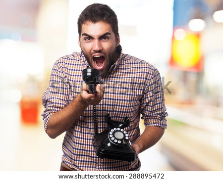 young man shouting telephone - stock photo