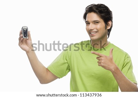 Young man showing a flip phone