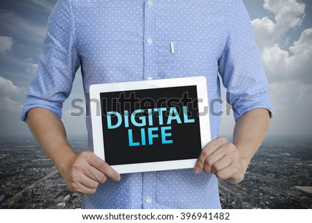 young man showing digital tablet with WEB DIGITAL LIFE in city , business concept ,business idea , analysis concept - stock photo