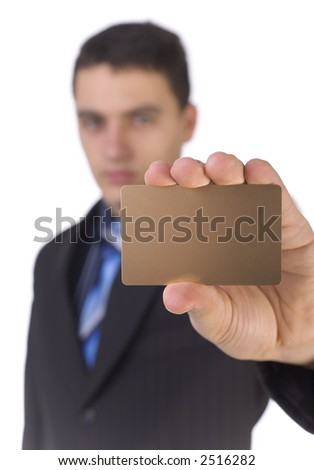 Young man showing gold card; White background in studio. Focus on the card. Body unfocus. - stock photo