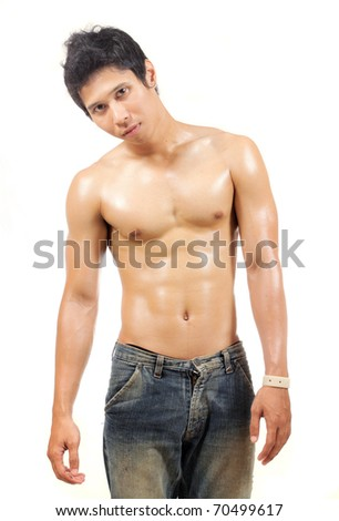 young man showing his body muscle - stock photo