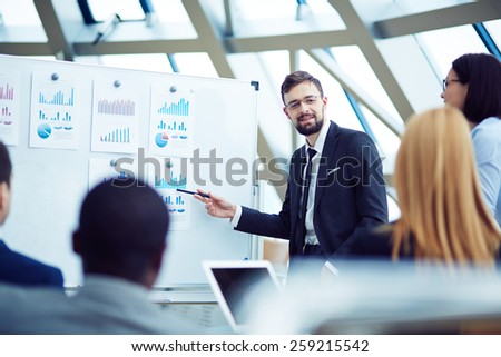 Young man Showing information to colleagues - stock photo