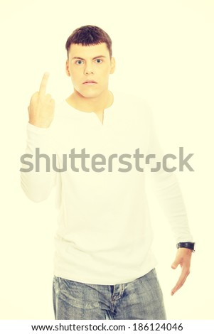 Young man showing middle finger - stock photo