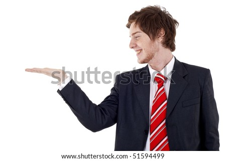Young man showing something on his hand over white - stock photo