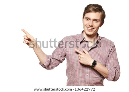 Young man showing something. Studio shot of young man. - stock photo