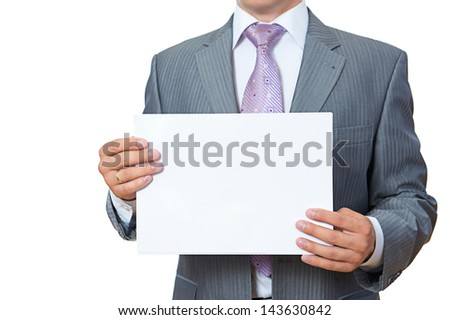 Young man shows blank paper - stock photo