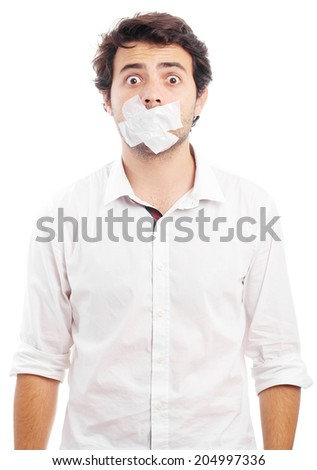 Young man silenced by tape - stock photo