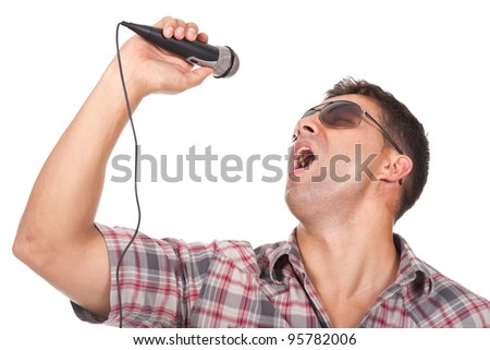 young man singing with a microphone on the hand - stock photo