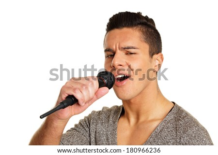 Young man sings into microphone - stock photo