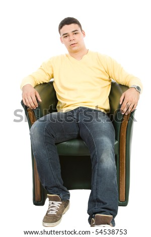 Young man sit on armchair isolate - stock photo