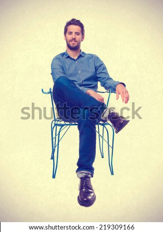 young man sitting - stock photo