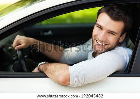 Young man sitting in a car  - stock photo