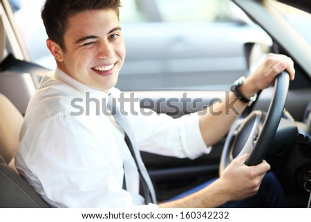 Young man sitting in car   - stock photo