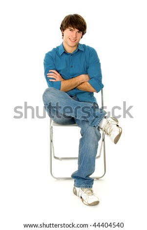 Young Man Sitting in Chair - stock photo