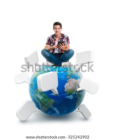 Young man sitting on a planet with a tablet. Elements of this image furnished by NASA - stock photo
