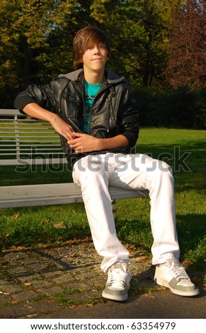 Young man sitting on bench in the park