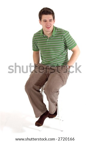 Young man sitting on stool - stock photo