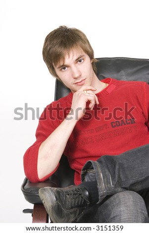 young man sitting on the chair - stock photo