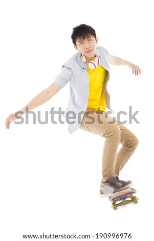 young man Skateboard to jump isolated on white background