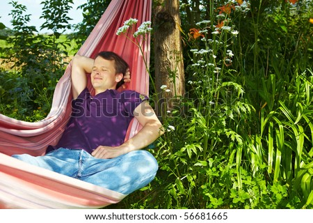 Young man sleeping relaxed in a hammock