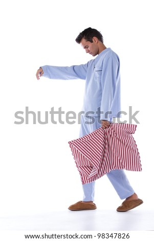 Young man sleepwalking dress with nightclothes (isolated on white)