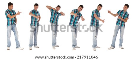 Young man smile looking at camera, pointing and holding thumb up gesture isolated over white background - stock photo
