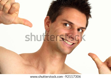Young man smiling and pointing at himself with success - stock photo