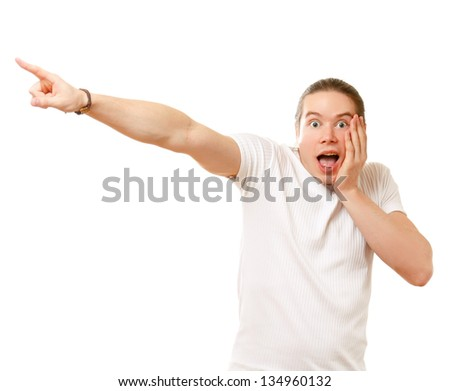 Young man smiling and pointing finger, isolated on white background - stock photo