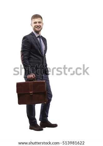 Young man smiling in a suit with a briefcase in his hands