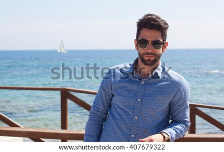 young man smiling in the beach