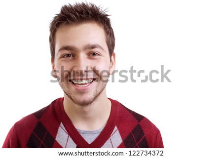 Young man smiling isolated on white background - stock photo