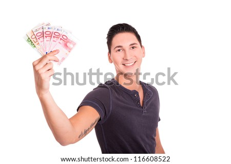 Young man smiling with Euro banknotes in his hands - stock photo