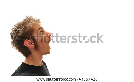 Young man spewing out blank empty copy space. Isolated on white.