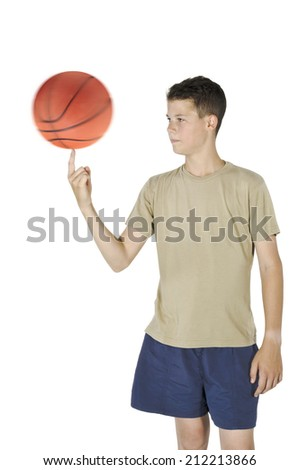 Young man spin the ball on his finger isolated with white background - stock photo