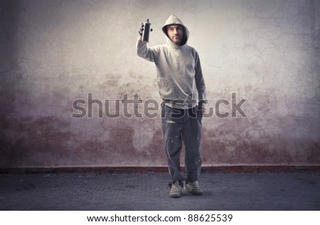 Young man spraying paint - stock photo