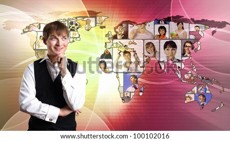 Young man standing against world map background - stock photo