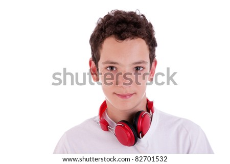 young man standing listening to music on red headphones, isolated on white, studio shot