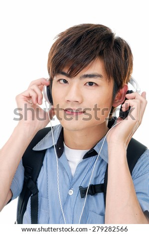 young man standing man with backpack with headphones. - stock photo