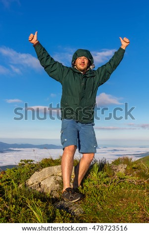 Young Man Standing On Top Mountain Stock Photo - This man hikes up the transylvanian mountains every morning to photograph sunrise