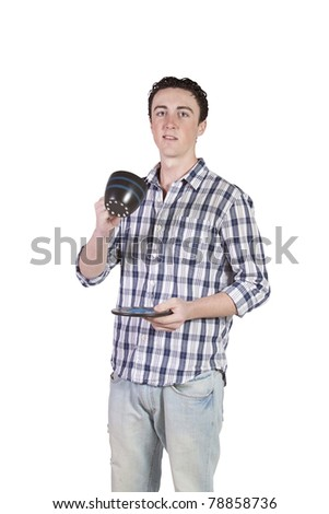 Young man standing while drinking coffee - isolated