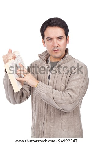 young man standing with a book in his and and pointing at the page