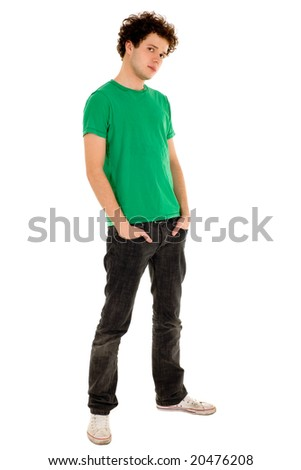 Young man standing with hands in pockets - stock photo