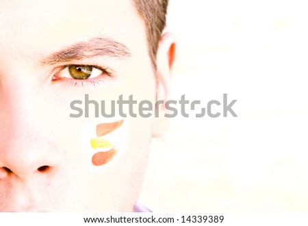 Young man staring at camera with Spanish color in his face. - stock photo