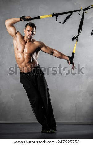 Young man stretching muscles making functional training - stock photo